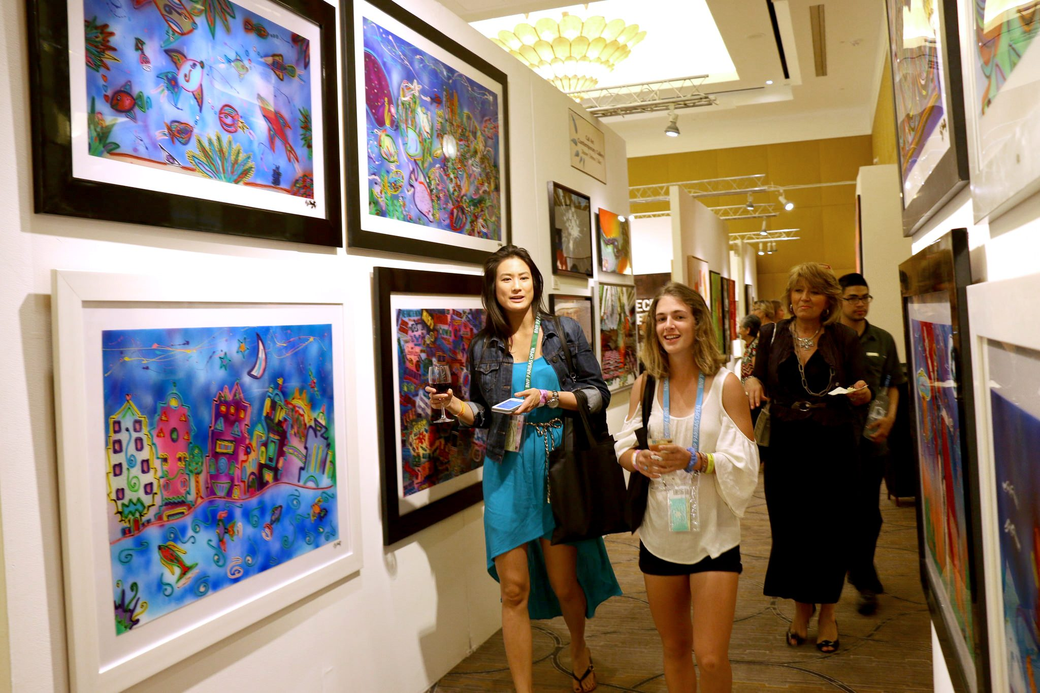 Showgoers stroll through booth after booth of striking contemporary art.