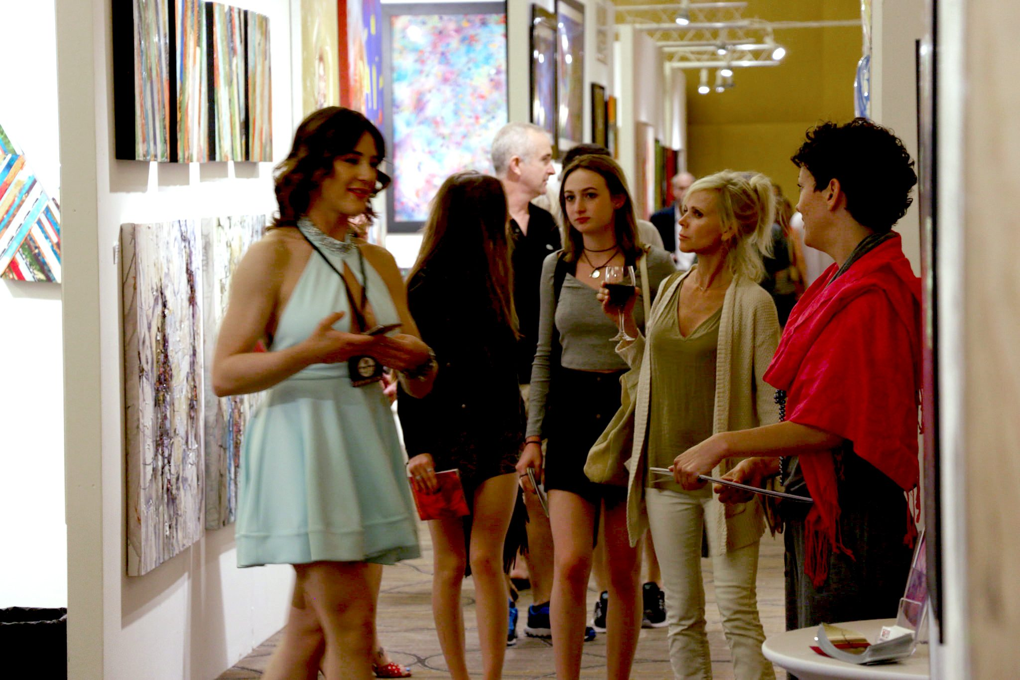 Crowds enjoyed complimentary wine and art from over 40 exhibiting galleries on the opening night of the show.