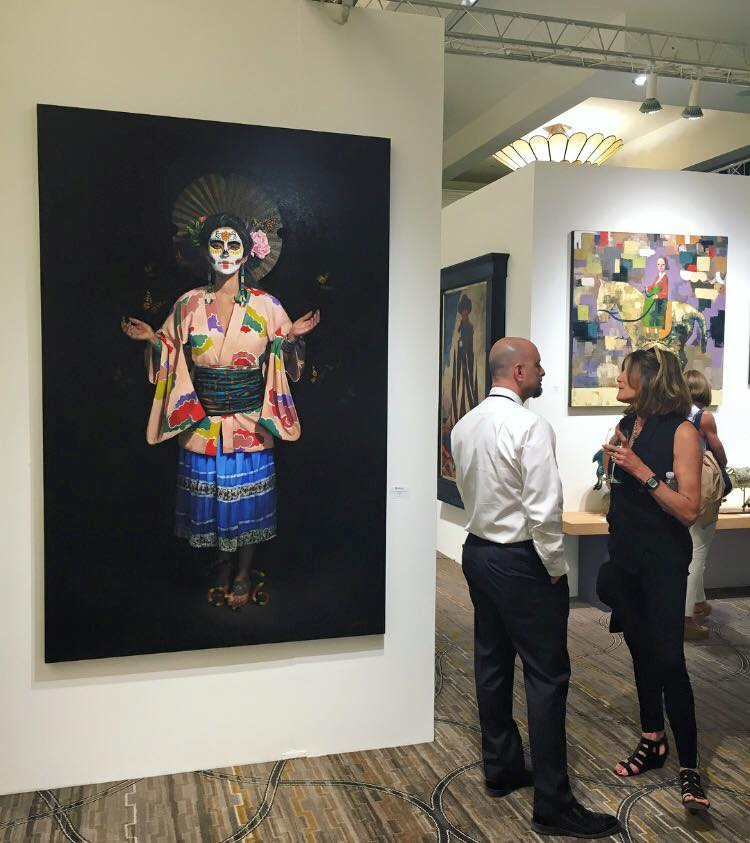 Blue Rain Gallery owner Leroy Garcia chats with a collector at Spectrum Indian Wells.